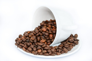 Coffee Beans pouring out of a cup